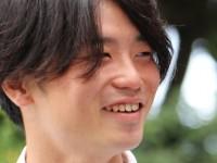 (8月15日、解散の日の奥田氏。普段見せない余裕のある笑顔 撮影:兼子草平氏)