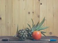 Pen-Pineapple-Apple-Pen on wooden background.